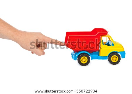 Toy car truck and hand isolated on white background - stock photo