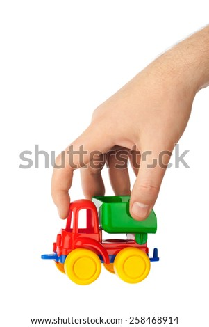 Toy car truck in hand isolated on white background - stock photo