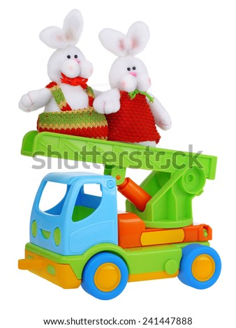 Toy car truck with easter rabbits isolated on white background - stock photo