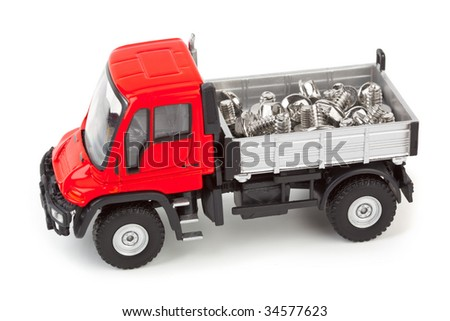 Toy car truck with screws isolated on white background - stock photo