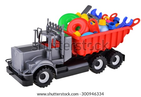 Toy car truck with toys and instruments isolated on white background - stock photo