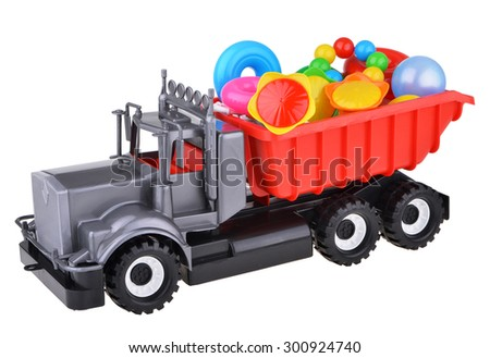 Toy car truck with toys isolated on white background - stock photo