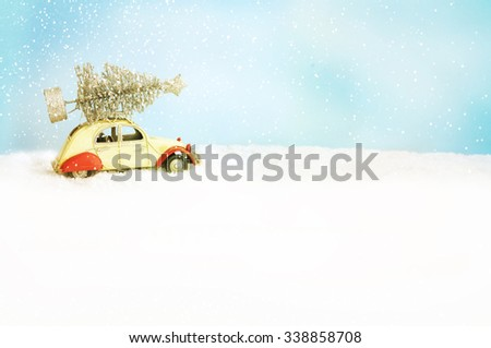 Toy car with Christmas tree - stock photo