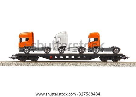 toy cargo wagon with trucks isolated on white background - stock photo