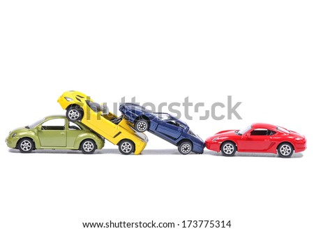 Toy cars in a simulated chain crash - stock photo
