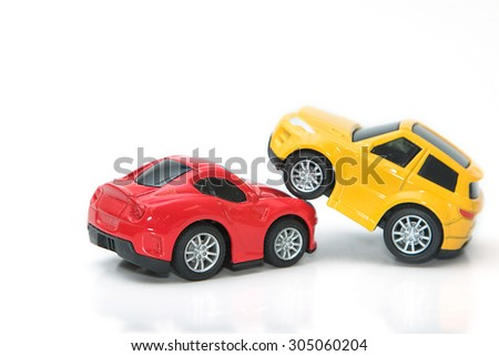 Toy cars in accident on a white background ,concept safety car - stock photo