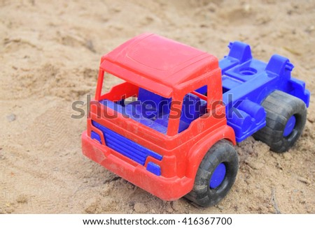 Toy cars in sand - stock photo