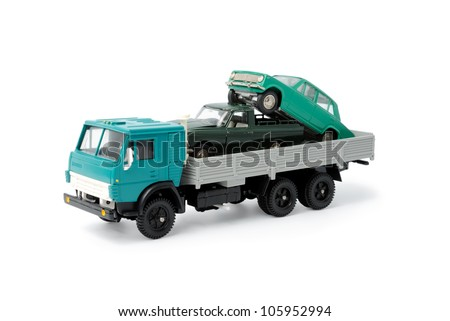 Toy cars in the back of toy truck on a white background