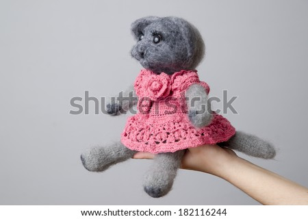 Toy cat on gray background. Gift for holiday. Handmade Felt. - stock photo