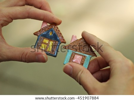 toy ceramic houses in hand