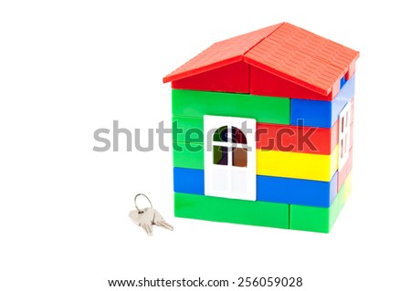 Toy, children's house and set of keys. Concept - stock photo