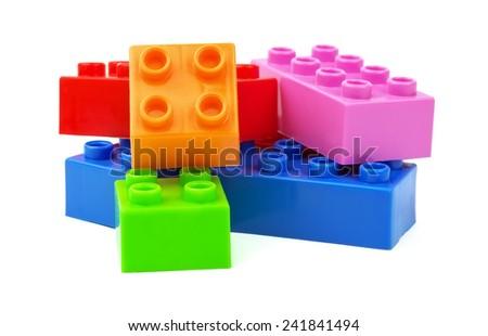 Toy colorful plastic blocks isolated on white background  - stock photo