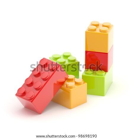 Toy construction brick red, green, orange blocks on white floor - stock photo