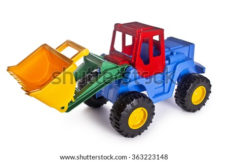 toy construction machinery,The toy tractor isolated on a white background - stock photo