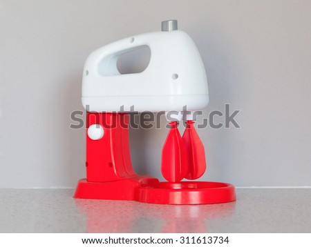 Toy cooking mixer or blender, isolated in the kitchen - stock photo