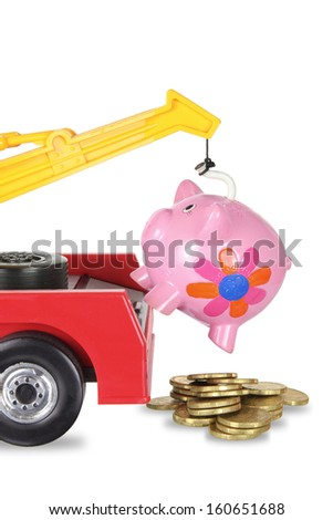 Toy Crane and Piggy Bank on White Background - stock photo