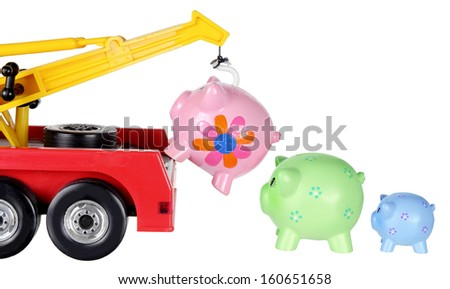 Toy Crane and Piggy Banks on White Background - stock photo