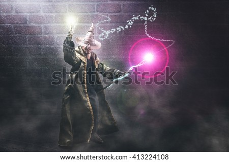 toy depicting a magician casting spells - stock photo