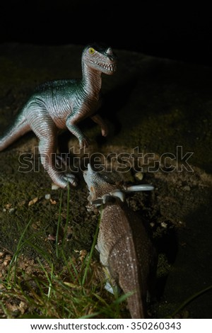 Toy dinosaur figurine in a real nature scenery outdoors