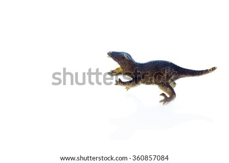 toy dinosaur velociraptor. miniature plastic toy dinosaur isolated on a white background - stock photo