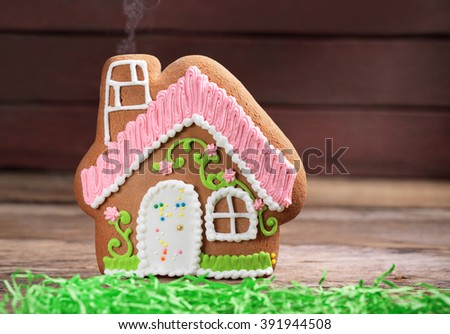 Toy gingerbread house on the wood table - stock photo