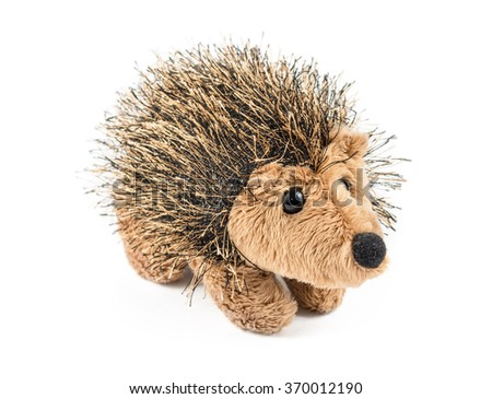 toy hedgehog, shot over white - stock photo