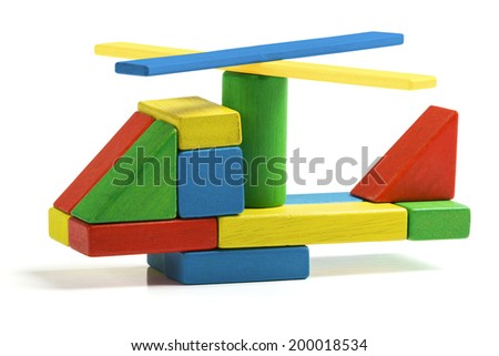 toy helicopter, multicolor wooden blocks air transport isolated white background - stock photo
