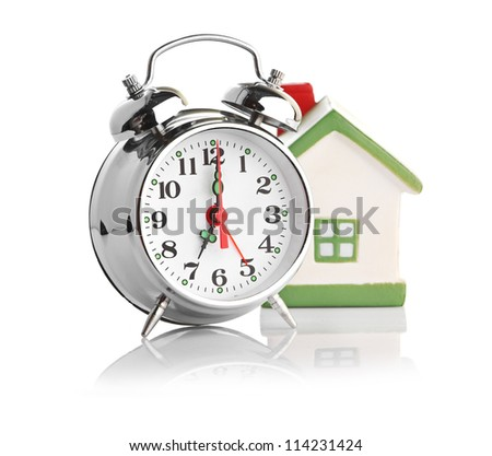 Toy House and alarm clock isolated on white - stock photo