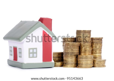 Toy house and coins in the form of the diagram