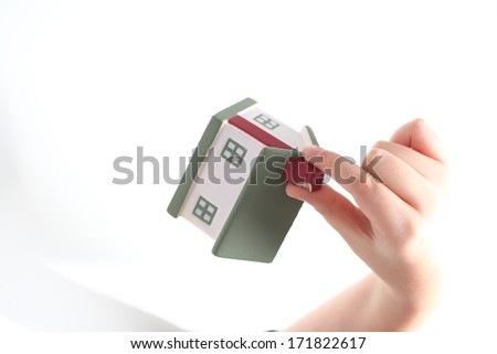 toy house in hands of the child