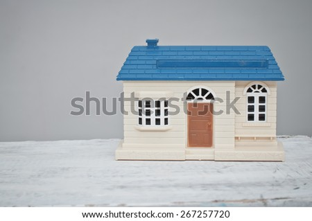 Toy house with blue roof and brown door  - stock photo