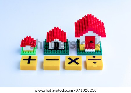 toy house with math symbol on white background.jpg - stock photo