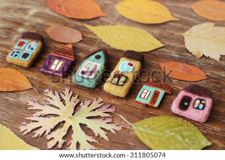 toy houses and dry leaves - stock photo