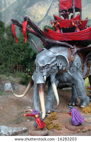 Toy kit of fantasy warriors and giant battle elephant - stock photo