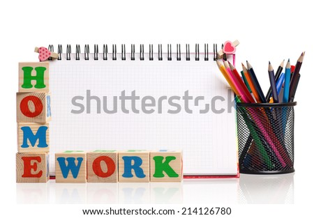Toy letters that spell homework and blank notebook over white background - stock photo