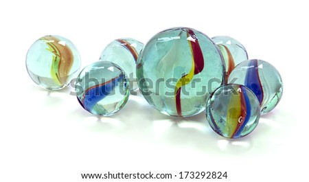 Toy marbles on white background - stock photo