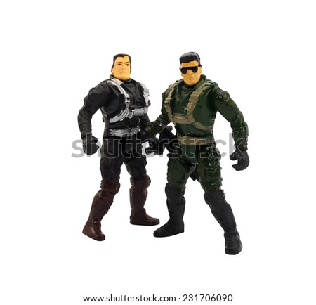Toy military soldiers.Two isolated toy plastic soldiers with guns standing. - stock photo