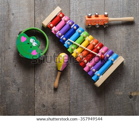 Toy Musical instruments collection on old wooden table. Top view. - stock photo
