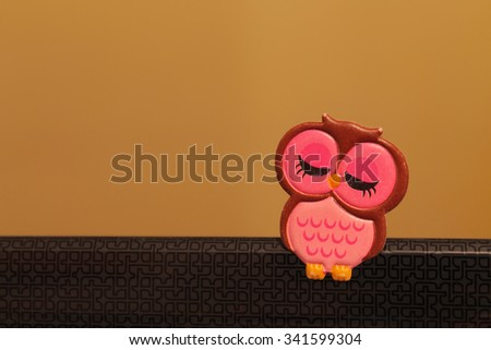 Toy owl sticker pasted on the laptop - stock photo