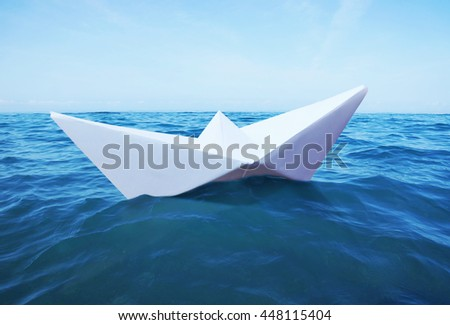 Toy paper ship sails on the sea - stock photo