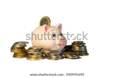 Toy piggy bank with coins, isolated - stock photo