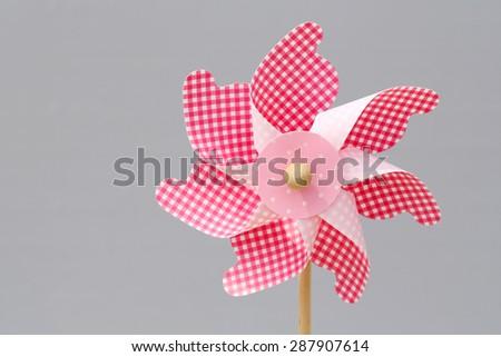 toy pinwheel in windy weather - stock photo
