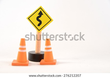 toy road sign with traffic cones