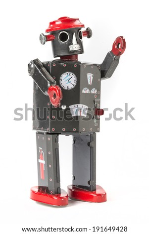 Toy Robot  from Childhood Vintage wind-up metal robot that walked and waved while shaking his head