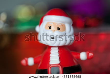 Toy Santa with blurred colored background