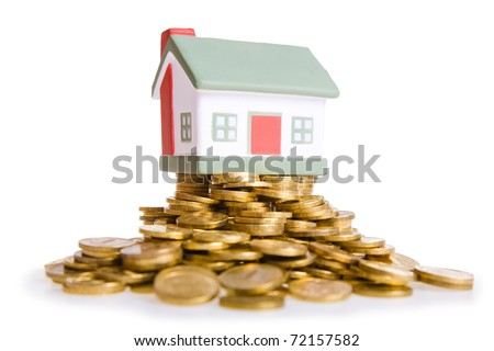 Toy small house standing on a heap of coins. The concept of purchase of habitation - stock photo