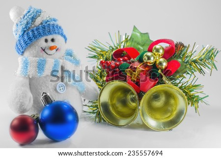 toy snowman Christmas decorations and bells - stock photo