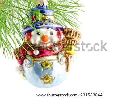 toy snowman on the green fir-branch christmas decoration isolated on white - stock photo