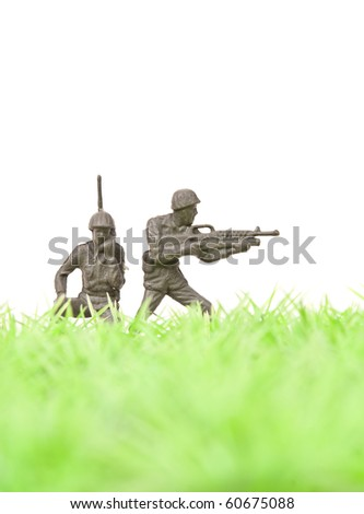 Toy Soldier Gunnner Providing Cover for Radio Man - stock photo