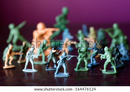 Toy soldiers and miniature figurine. Concept photo of world war, conflict and warfare. - stock photo
